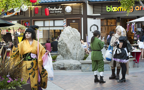Youths attend Nisei Week festivities costumed in the makeup and garb of anime characters.
