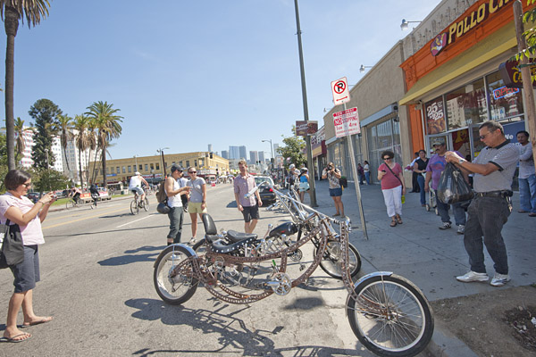 Two unique custom bikes draw a crowd of photographers near MacArthur Park.