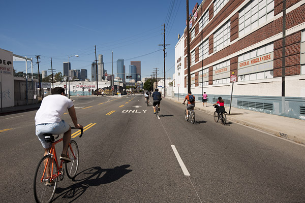 Cyclists pedal down Seventh Street in the manufacturing district east of Downtown L.A.