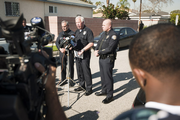 LAPD Deputy Chief Patrick Gannon briefs the media and local residents at the command center south of the campus. Gannan asserts that one round from a gun inside a student's backpack was accidentally discharged when the student dropped his backpack onto a desk.