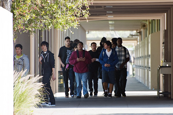 Students walk between buildings at Gardena High School on Tuesday, January 18, 2011, while the campus is locked down by police. Police sealed off the area following the accidental discharge of a student's gun that injured two classmates, including one with critical head injuries.