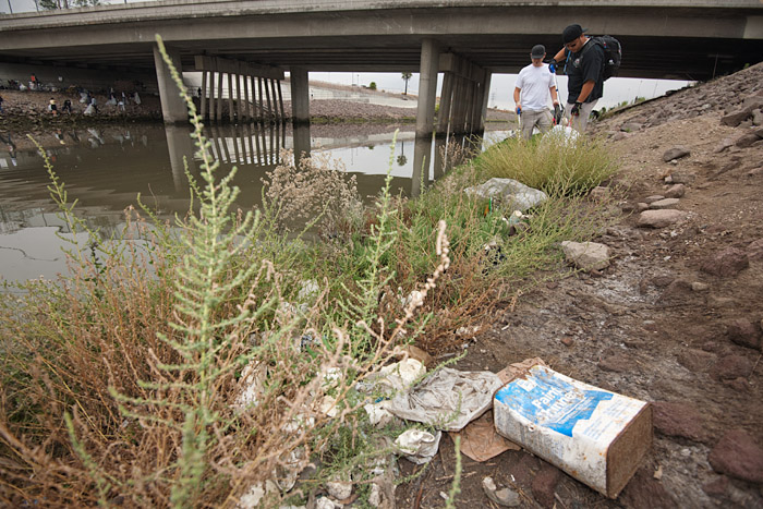 A used container of paint thinner lies along the heavily polluted waterway. The area was labeled one of five code red sites in Los Angeles by Heal the Bay engineers due to the large amount of waste accumulated there.