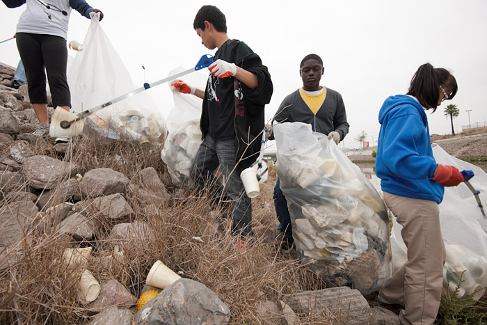 Students of Serra High School, a private Catholic school in Gardena, must complete twenty hours of community service yearly. According to a teacher working alongside the students, the main reason the community takes care of the local environment is because