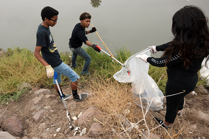 Serra High School students work the bank of the channel.