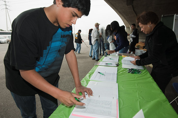 A student signs up for a morning of community service.
