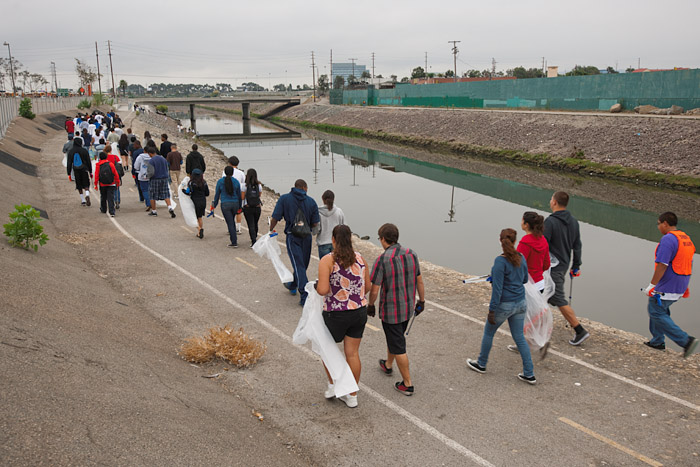 Banning High School and Serra High School students walk along the bike path bordering the Dominguez Channel. The Dominguez Channel near the Artesia Transit Center in Gardena was selected by organizers as one of five code red sites in the Los Angeles area due to the high level of environmental degradation.