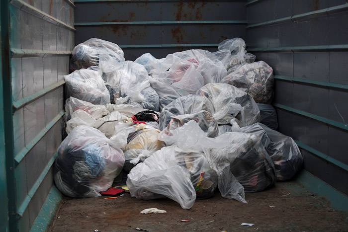 By the end of the event, the partially filled dumpster was full of nearly thirty cubic yards of garbage.