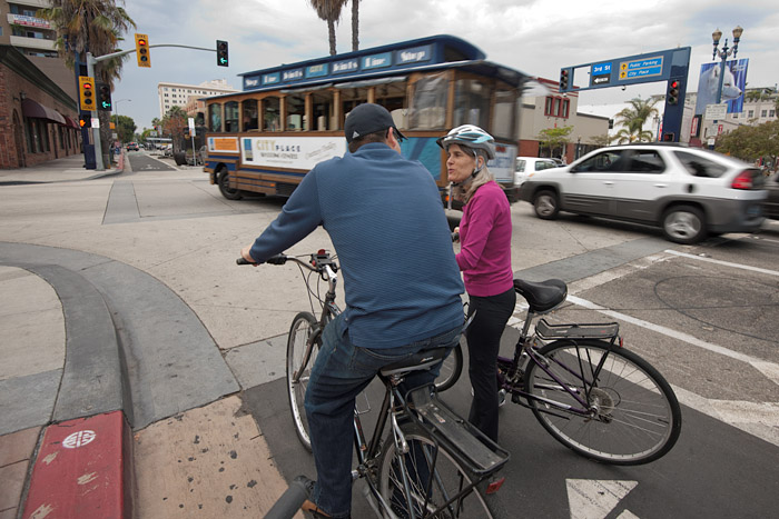 Signalized intersections have left turn arrows for motorists and special signals for bicyclists.