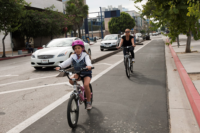 The installation of a bike lane with a curb separating cyclists and motorists makes Broadway safe for small children on bikes. A child would be an unlikely rider without a protected bike lane.