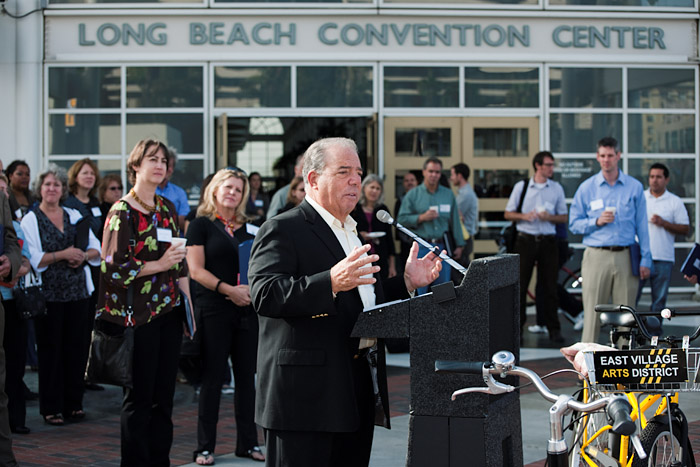 Long Beach Mayor Bob Foster, a cyclist who attempts to ride 100 miles per week, speaks at the press conference.