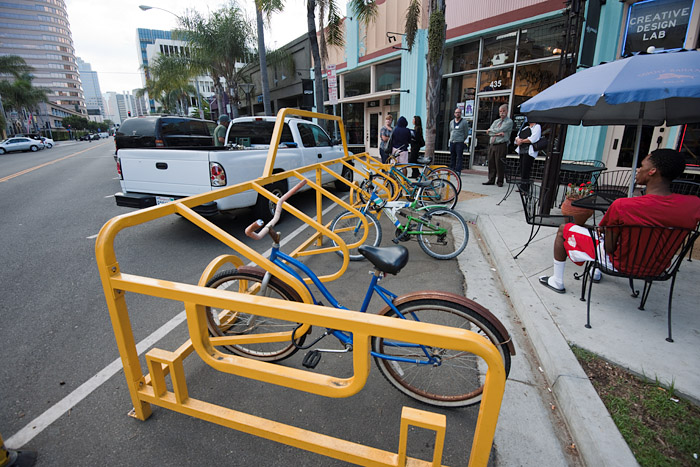 A bike corral is installed in what used to be a parking place for a single automobile on First Street.