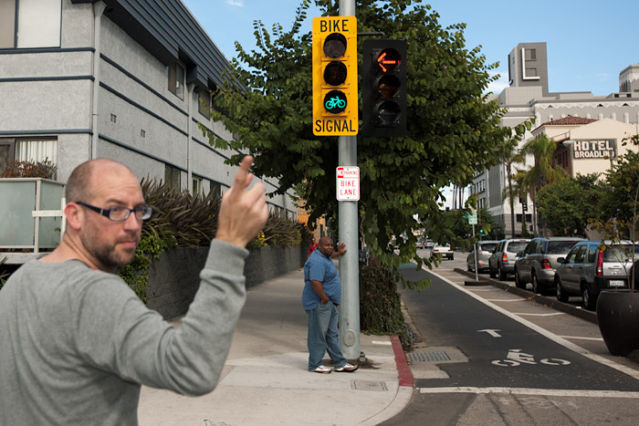 Ryan Snyder points to the bike signal at the intesection of Broadway Avenue and Elm Avenue.