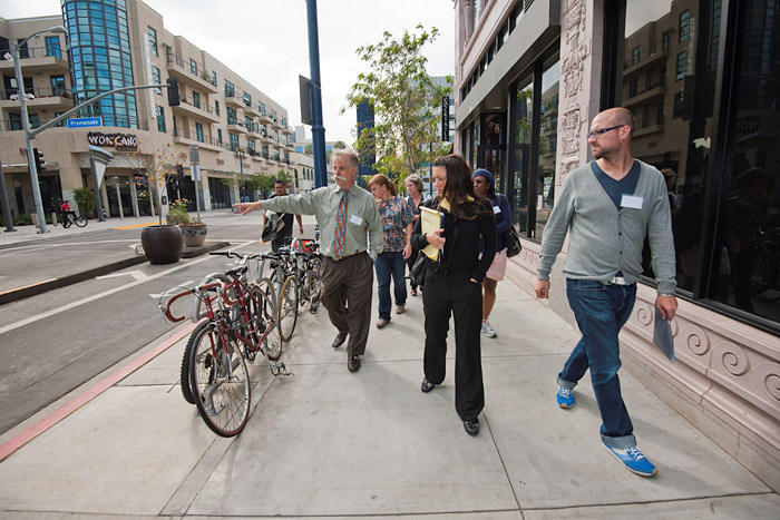 Rock Miller (left) and Ryan Snyder (right) lead a walking tour of bike friendly roads and facilities in downtown Long Beach.
