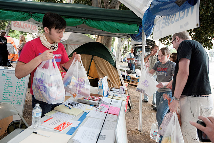 On the thirtieth day of occupation, people donate food at the welcome tent on First Street, Sunday, October 30, 2011.