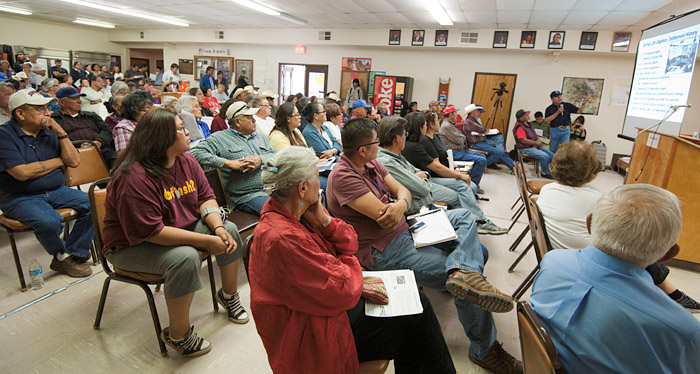 A Navajo tribal spokesman displays a powerpoint presentation in English while speaking in Navajo to attempt to explain the language of Senate Bill S 2109 on Wednesday, April 25, 2012, in Teesto, Arizona.