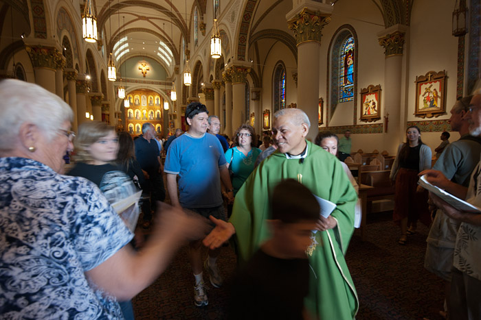 Father Peter M. Aquino, a priest visiting from New Jersey, thanks parishioners after mass at the St. Francis Cathedral Basilica in Santa Fe, New Mexico, on Sunday, July 8, 2012.