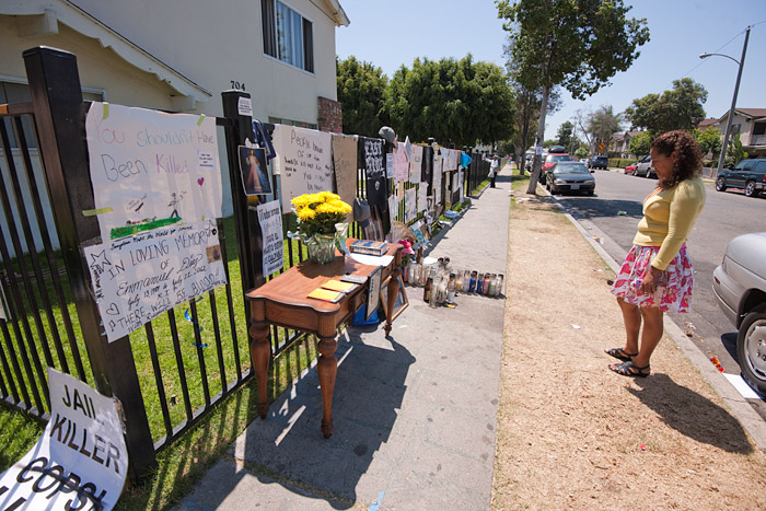 An Anna Drive resident views the shrine marking the site of the killing of Emmanuel Diaz by Anaheim Police.