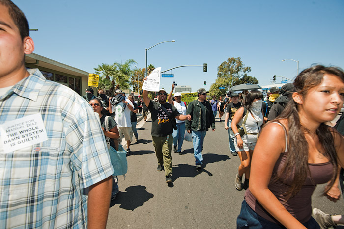 Protestors march down Harbor Boulevard in defiance of police orders.