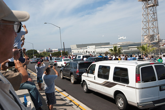 Thousands of people viewed the event from office windows, rooftops, public parks, sidewalks and streets. Spectators some double-parked and stopped on the road, line Imperial Highway south of LAX, to witness and photograph the landing.