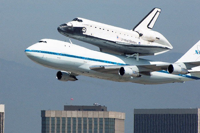 Endeavour flies by the Los Angeles International Airport before circling and landing.