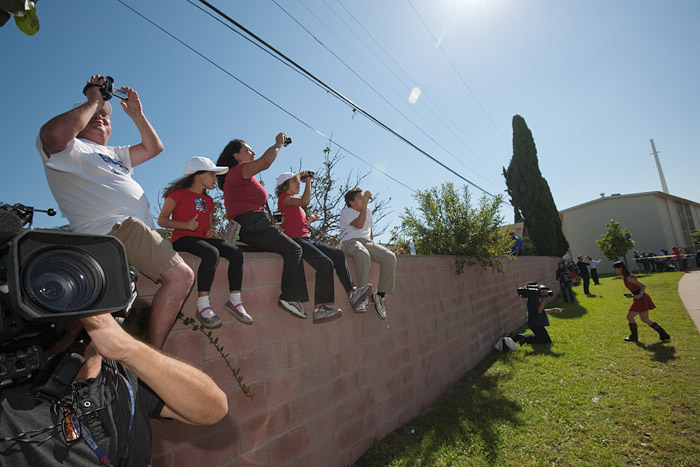 Media workers and residents with property next to La Tijera Boulevard avoid police lines to view the space shuttle.