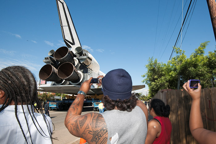 Residents snap photos of the three main engines.