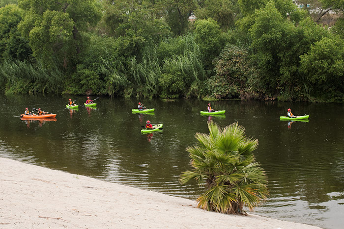 Kayaks wend through the Los Angeles River.