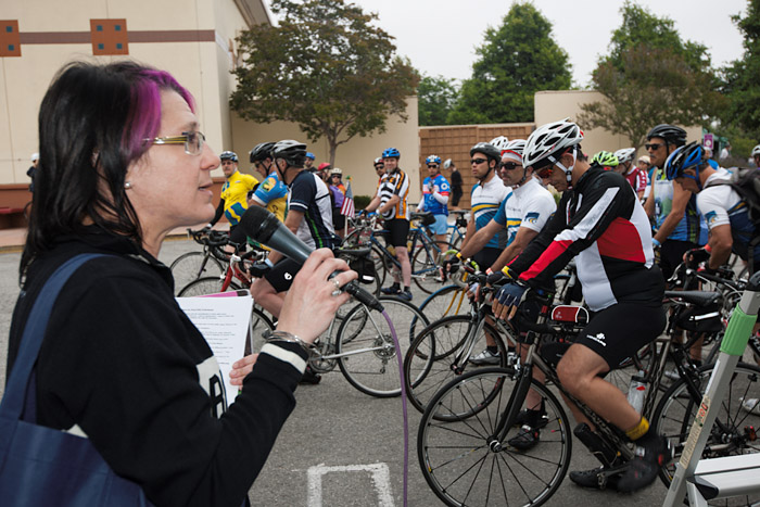 Jennifer Klausner, executive director of the LACBC, addresses riders at the start of the 50 mile ride.