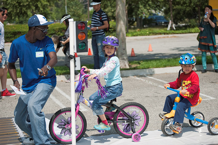 Children take a lesson in urban cycling safety.