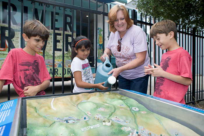 Shelly Backlar, Friends of the Los Angeles River (FoLAR) Director of Education Programs, demonstrates on a model how water flows through the Los Angeles Basin.