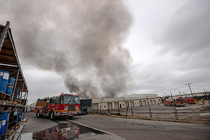 Firefighters respond Tuesday, July 21, 2015, to an industrial fire near Gardena Boulevard in Carson, California. Workers reported that titanium filings spontaneously combusted in the unusually muggy weather.