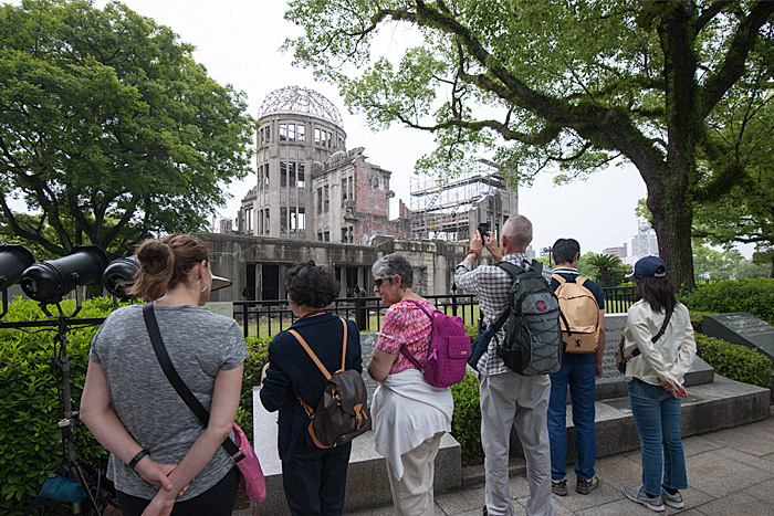 People view the genbaku dome, the A-Bomb Dome, epicenter of the blast that destroyed the city of Hiroshima and killed over 100,000 of its residents. On the afternoon of Friday, May 27, 2016, Barack Obama will become the first sitting U.S. president to visit the city.
