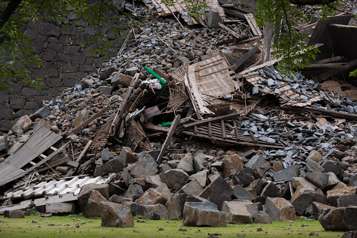Debris and rubble remain at the base of a broken wall at Kumamoto Castle on Monday, June 5, 2016, six weeks after the castle suffered heavy damage from a series of strong earthquakes.