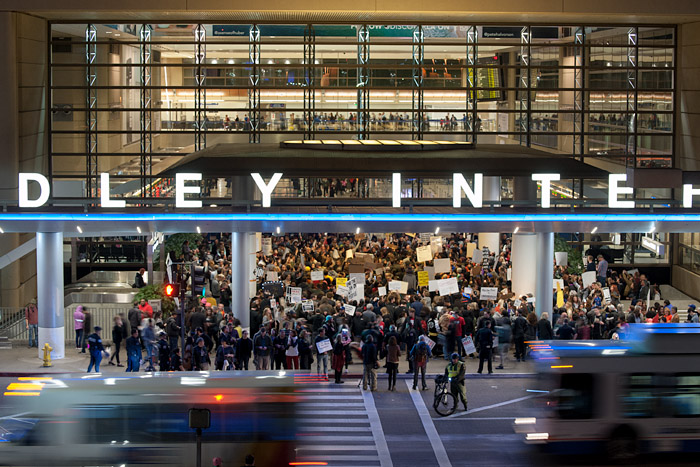 Protestors crowd the entrance to the Bradley International Terminal at LAX on Saturday, January 28, 2017, in response to newly sworn-in President Trump's executive order banning entry into the United States for Muslims from six countries.