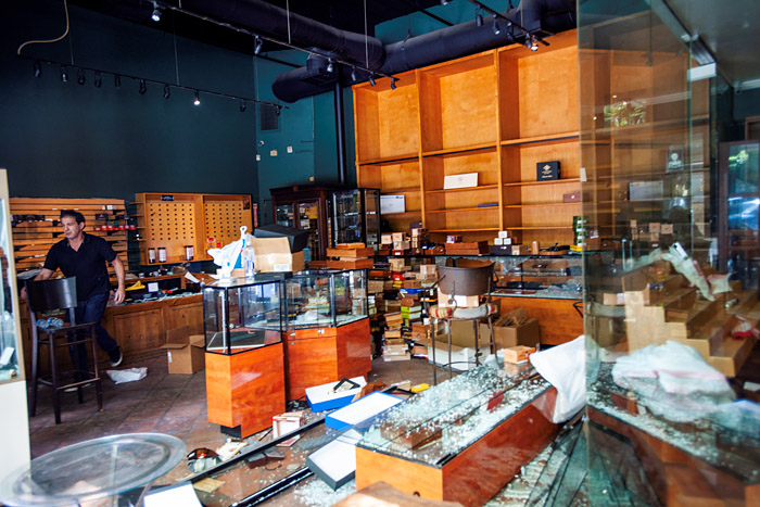The presumed owner responds to an offer of volunteer assistance at his ransacked cigar shop on Broadway in Santa Monica.