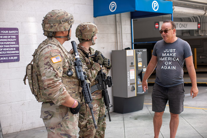 Just Make America OK Again. Tom Arnold chats with National Guard members patrolling Broadway in Santa Monica, Monday, June 1, 2020.